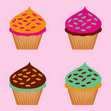 一套杯形蛋糕的颜色 免版税库存照片