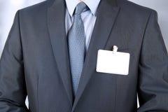一套现代衣服的商人与一枚空白的徽章 免版税库存图片