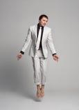 一套白色昂贵的衣服的成人人 免版税库存图片