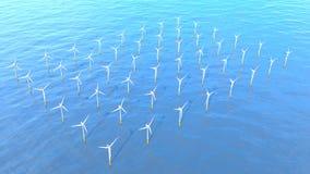 一套的鸟瞰图日间形成风力场的涡轮在海洋中间有天空蔚蓝的 免版税库存图片
