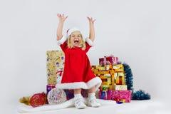 一套红色圣诞节服装的甜女孩 库存图片