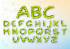 一套绿色焦糖信件 明亮的传染媒介新年的字体 ABC 镶边动画片字母表 皇族释放例证