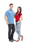 一对偶然年轻夫妇的全长画象 图库摄影