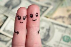 一对愉快的夫妇的手指艺术 男人和妇女在金钱背景拥抱  免版税图库摄影