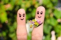 一对愉快的夫妇的手指艺术 图库摄影