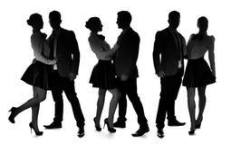 一对浪漫爱恋的夫妇的三个剪影 免版税图库摄影