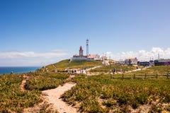 一座灯塔的好的看法有海洋的在葡萄牙 图库摄影