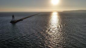 一座灯塔的风景在日落的 库存图片
