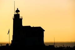 一座美丽的海滩和灯塔在日出(Marken Netherla 库存照片