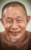 一张亚洲老人愉快的面孔 库存图片