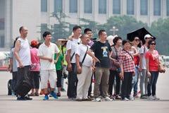 一张照片的在天安门广场,北京,中国旅游小组姿势 图库摄影