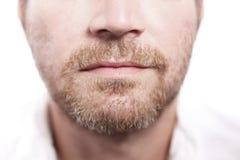 一张男性面孔的特写镜头 免版税库存图片