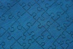 一张纸的蓝色背景难题 免版税库存照片