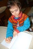 一张逗人喜爱的男孩绘画 库存照片