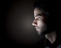 一张面孔的黑暗的画象在外形的 免版税图库摄影