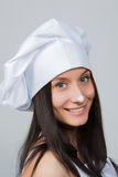 一微笑的女性厨师打手势的画象 库存照片