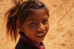 一愉快的小女孩瓜拉尼巴拉圭货币单位的画象 库存图片