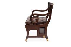 一把古色古香的木扶手椅子的侧视图 图库摄影