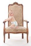一把古色古香的椅子的男婴 库存图片
