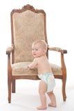 一把古色古香的椅子的男婴 库存照片