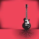 一把吉他作为一棵树有根背景 免版税库存图片