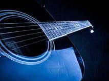 一把声学吉他的特写镜头照片由a使用了 免版税图库摄影