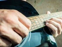 一把声学吉他的特写镜头照片由a使用了 库存照片