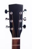一把声学吉他的黑雕头 免版税库存图片