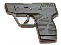 一把小黑手枪有白色背景 库存图片