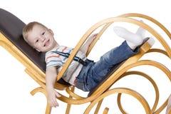 一把摇椅的孩子 库存图片