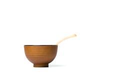 一把木匙子和饭碗 免版税图库摄影