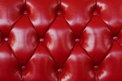一把红色皮革扶手椅子的背景 免版税库存图片