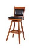 一把老木和黑乙烯基椅子 库存图片