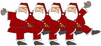 一排合唱圣诞老人 库存照片