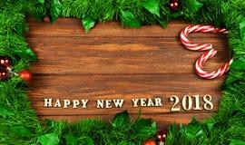 一新年好的文本在圣诞节tre的框架的2018年 免版税库存照片