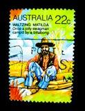 一旦一名快活的流浪汉由在价值的一billabong野营在22分,在澳大利亚打印的邮票显示跳华尔兹的马蒂尔达的图象 库存照片