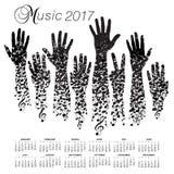 一本创造性的2017音乐会日历做用手 库存图片