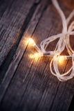 一本欢乐圣诞节诗歌选的三个LED电灯泡 免版税库存照片
