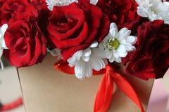 一朵玫瑰的美丽的花在箱子的 图库摄影