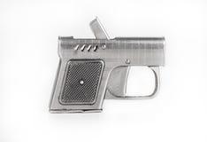 以一杆枪的形式打火机在轻的背景 免版税图库摄影