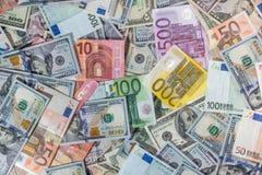 一束两主导的货币-美元和欧洲钞票 免版税图库摄影