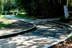 一条弯曲的路-公园的角落 库存图片