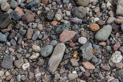 从一条河的石头作为背景 免版税图库摄影