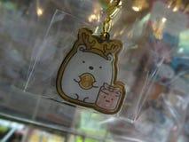 一条滑稽的日本钥匙链的接近的图片 免版税库存照片