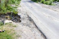 一条狭窄的农村路的模糊的边缘 免版税库存图片