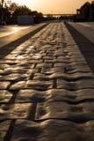 一条石路日落在万坪古城在丰台区,北京 图库摄影