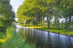 一条运河的边缘在日出的 库存照片