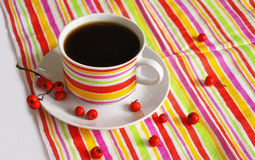 一杯咖啡和一块镶边布料 免版税库存图片