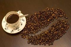 一杯咖啡和咖啡豆 库存照片