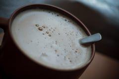 一杯咖啡在背景的 免版税库存照片